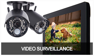 Image of 2 video surveillance cameras with their live feed displaying on a laptop.